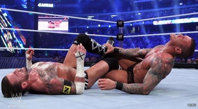 http://images4.fanpop.com/image/photos/20700000/Wrestlemania-27-CM-Punk-vs-Randy-Orton-wwes-the-nexus-20741521-675-373.jpg