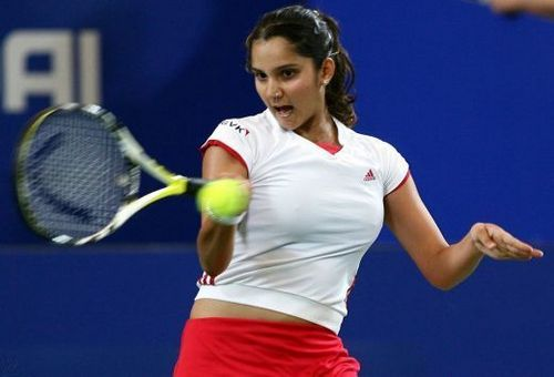 Tennis wallpaper with a tennis racket, a tennis pro, and a tennis player titled sania mirza hot breast