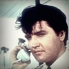 Elvis Presley photo probably with a business suit and a portrait called *Clambake*
