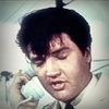 Elvis Presley photo probably with a portrait entitled *Clambake*