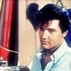 Elvis Presley foto probably containing a portrait called *Clambake*