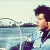 Elvis Presley photo probably containing a pontoon called *Clambake*