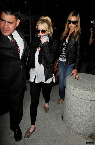 Lindsay Lohan Arriving JFK Airport and LAX Airport on 04/06