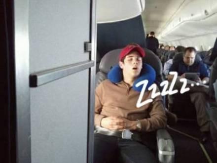 Nick Jonas sleeping a plane
