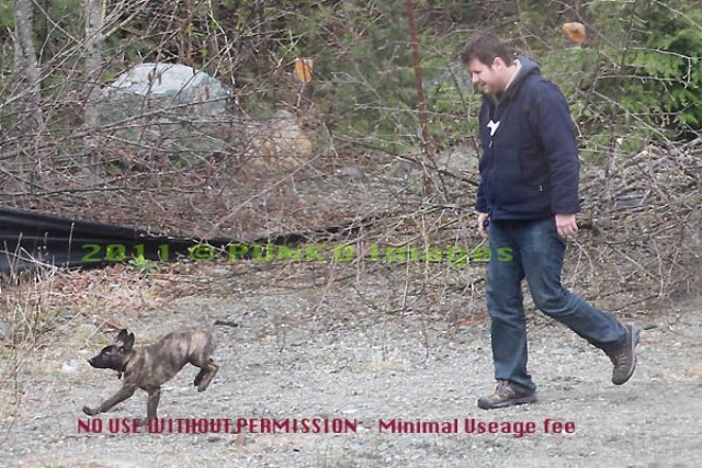 Pic of Rob's new dog kubeba walking with Kristen's Assistant John!