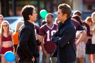 Damon and Stefan Salvatore پیپر وال probably containing a business suit and a سٹریٹ, گلی entitled salvatore brothers<3