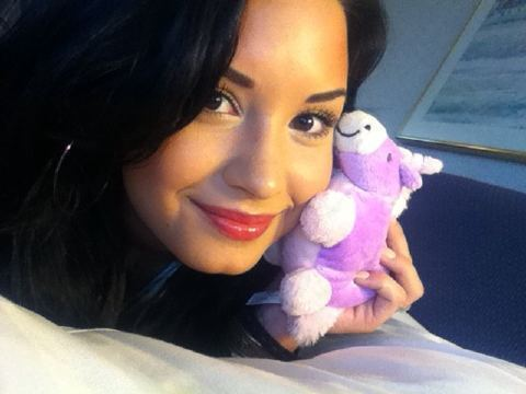 Demi Lovato karatasi la kupamba ukuta probably containing a portrait titled Go cuddle with a unicorn ;)