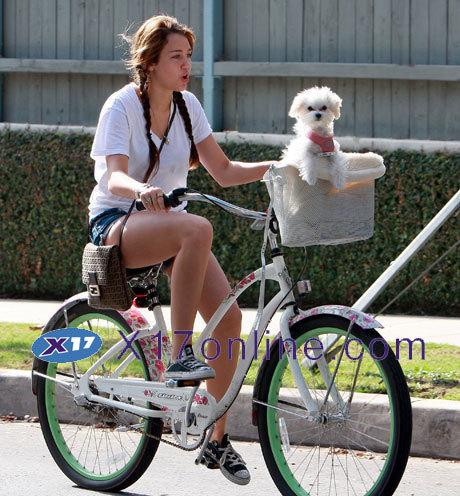Miley_riding bike