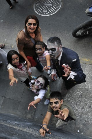 Zombies wallpaper probably with a street called family zombie