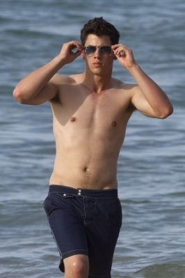 Nick Jonas Hintergrund containing swimming trunks and a stück, hunk entitled Nick SHIRTLESS 04/20
