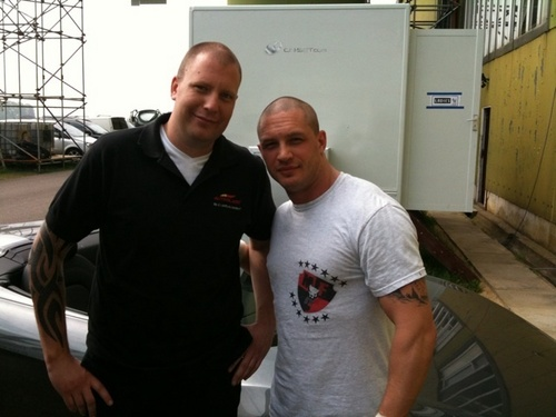 The Dark Knight Rises Обои probably with a nuclear reactor, a workwear, and a control tower titled Tom Hardy on the set