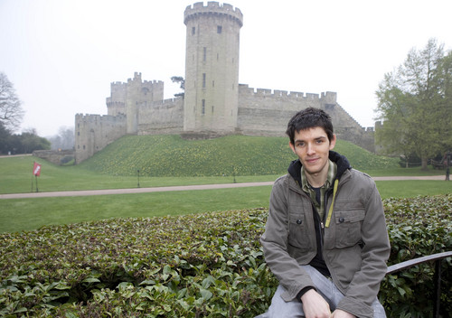 Colin morgan Hintergrund probably with a street, a martello tower, and a laubdecke, mulch called Colin morgan