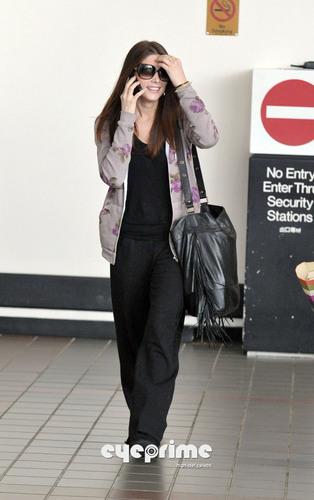 Ashley Greene touches down at LAX, Apr 23
