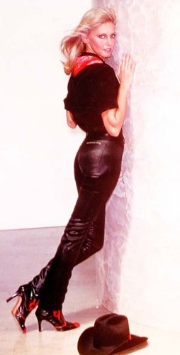 Olivia Newton-John wallpaper probably with a hip boot and a fountain titled Olivia Newton-John - Totally Hot photoshoot