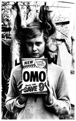 Olivia Newton-John wallpaper probably with a sign and a newspaper called Olivia as a teenager