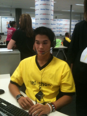 Booboo taking donations in the phone room at Telethon