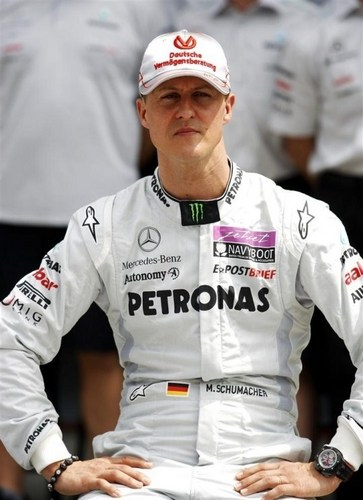 Michael Schumacher wallpaper probably containing a wicket, a first baseman, and a right fielder entitled Schumi