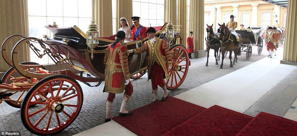 A helping hand: Kate's new husband Prince William helps her out of the carriage