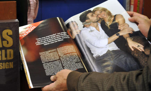 A man takes a look at the last edition of the Colombian magainset Caras, where the Colombian singer