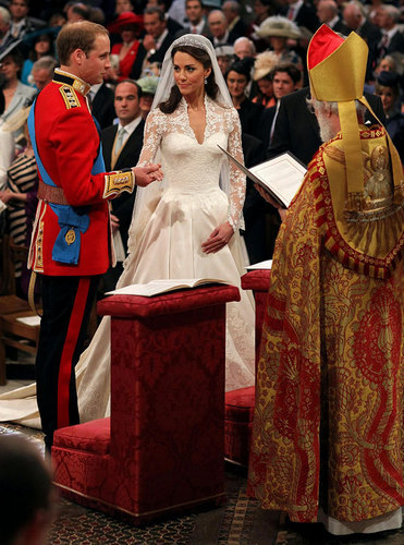 Prince William and his wife Kate Middleton taking their wedding vows