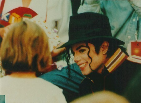 michael smile at a woman