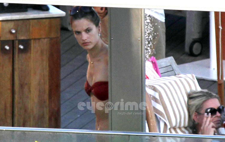 alessandra ambrosio looks stunning in an orange bikini on