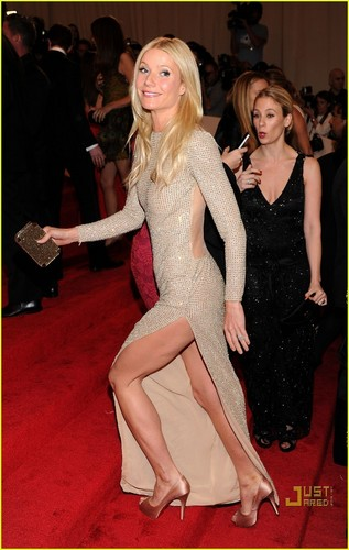 Gwyneth Paltrow wallpaper with bare legs, tights, and a bustier entitled Met Gala 2011