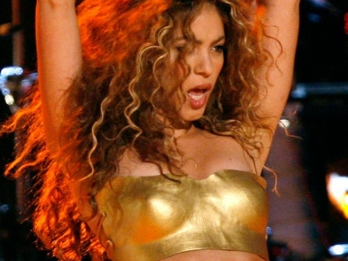 YouTube wallpaper titled Shakira gold nipple...