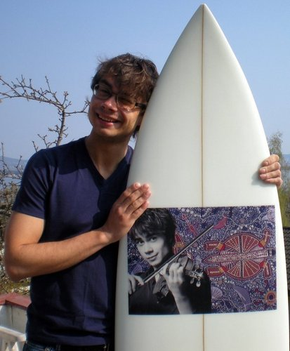 Alex and his awesome present from a fan, a surfboard!