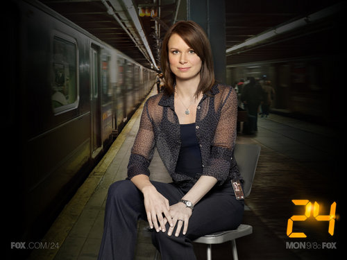 Chloe O'Brian wallpaper probably containing a street and a business suit titled Chloe