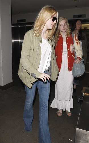 Dakota and Elle Fanning arriving at LAX Airport (May 3).