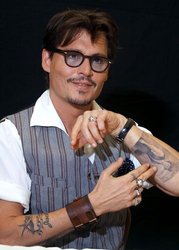 Johnny Depp wallpaper called JOHNNY DEPP- Press Conferences - Pirates of the Caribbean 4 - Los Angeles (04/05/2011)
