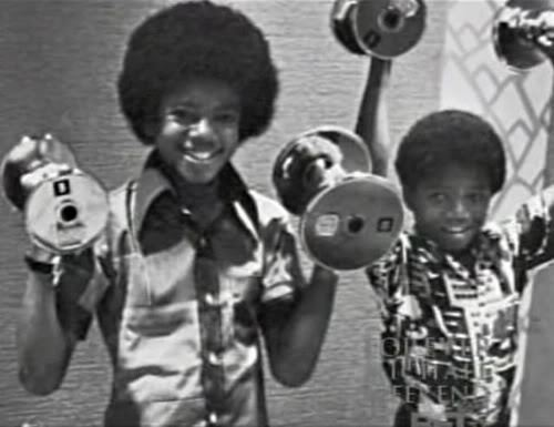 Michael lifting weights with lil' bro randy lol! :)