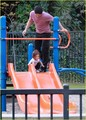 Cam with his daughter on playground in LA - cam-gigandet photo