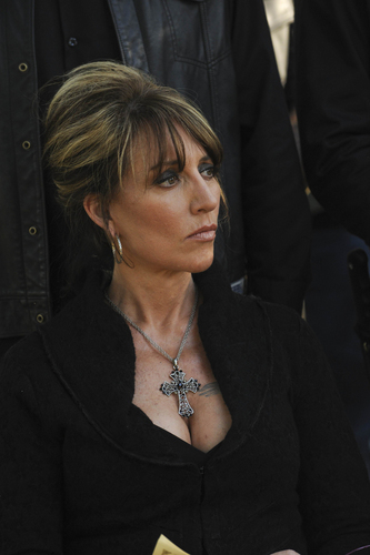 Gemma Teller Morrow wallpaper probably containing a well dressed person, an outerwear, and a leisure wear titled Gemma Teller Morrow