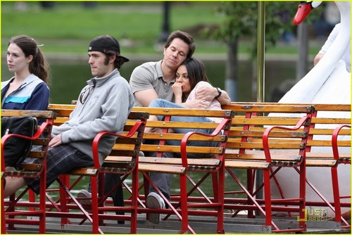 Mila Kunis achtergrond possibly containing a chuck wagon entitled Mila Kunis: Cuddling with Mark Wahlberg