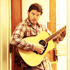 Parks and Recreation photo with an acoustic guitare entitled Andy Dwyer