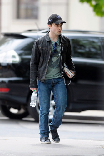 Daniel Radcliffe listens to his iPod while out for a stroll in New York
