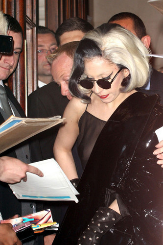 Lady Gaga emerges from her London Hotel in a see-through dress and pvc kot
