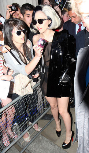 Lady Gaga emerges from her London Hotel in a see-through dress and pvc jas