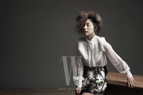 Shin Se Kyung wallpaper possibly containing an outerwear, a playsuit, and long trousers called Shin Se Kyung - For W Korea