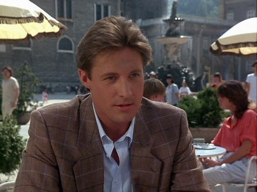 Scarecrow and Mrs. King achtergrond probably containing a business suit, a parasol, and a straat entitled Bruce Boxleitner as Lee Stetson