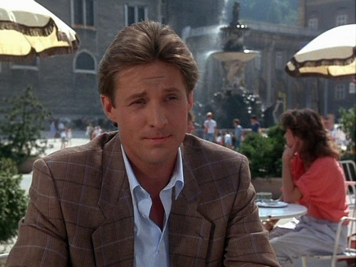 Scarecrow and Mrs. King wolpeyper containing a business suit called Bruce Boxleitner as Lee Stetson
