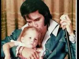 Elvis Aaron Presley and Lisa Marie Presley wallpaper probably with a neonate titled Kiss