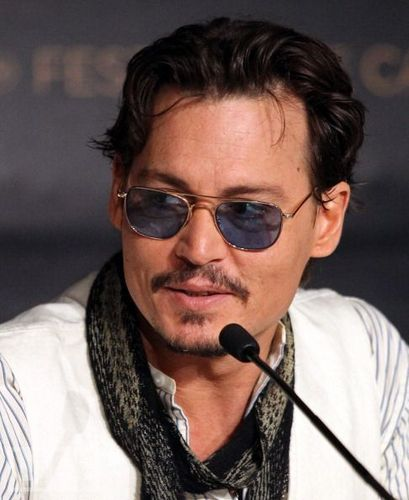 Johnny Depp wallpaper probably with sunglasses titled Press Conference