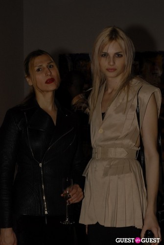 andrej pejic Hintergrund with a trench mantel entitled andrej