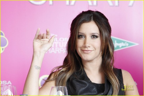 Ashley Tisdale Signs in Spain