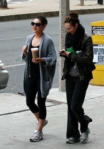 Mila Kunis picks up a quick caffeine fix before hitting the gym.