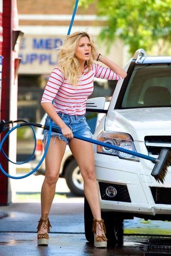 Ashley Is Washing A Car