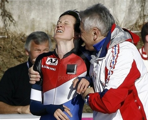 Czech Republic's Martina Sablikova is congratulated 의해 her coach Petr Novak after winning